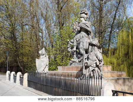 PolandWarsaw.Statue of King John III Sobieski in Warsaw near Lazienki Royal Park.Sculpture carved by Francis Pinck placed opposite the Palace Lazienki on Agricola Street designed by Andrew Le Brun.Horizontal close view from right side.Photo was taken in A poster
