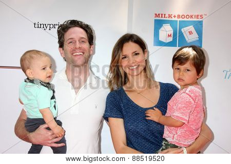 LOS ANGELES - FEB 19:  Glenn Howerton, Jill Latiano, children at the Milk+Bookies Sixth Annual Story Time Celebration at the Toyota Grand Prix Racecourse on April 19, 2015 in Long Beach, CA