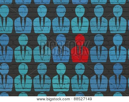 Business concept: business man icon on wall background