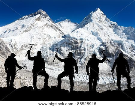 Silhouette Of Men With Ice Axe In Hand, Mount Everest