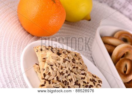 Sweet Cake On White Plate And Fruits