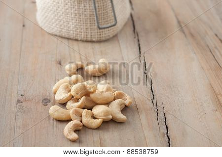 Small Pile Of Raw Cashew Nuts On Wooden Background