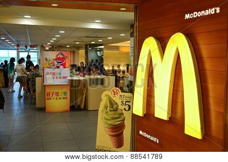 HONG KONG - APRIL 03, 2015: McDonald's restaurant interior. The McDonald's Corporation is the world's largest chain of hamburger fast food restaurants, serving around 68 million customers daily