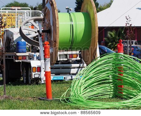 Fiber optic cable behind installation truck