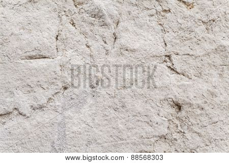 Uneven Surface Texture Of An Ancient Square Stone