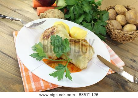 Braised Cabbage Roulade With Potatoes And Sauce