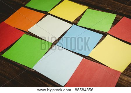Colorful sticky post its on wooden background