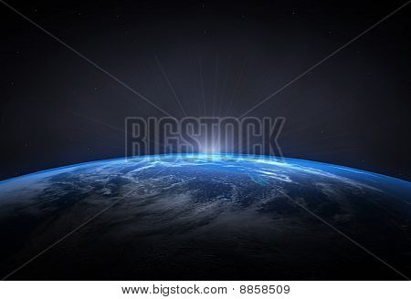 Beautiful planet Earth and the rising Sun