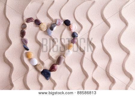 Decorative Pebble Heart On Golden Beach Sand