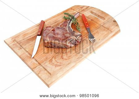 meat food : grilled beef spare rib on wooden plate with thyme isolated over white background