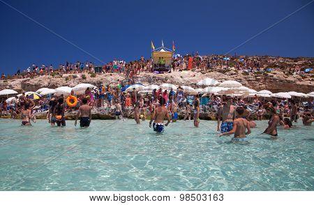 Sunbathing At Blue Lagoon - Comino, Malta