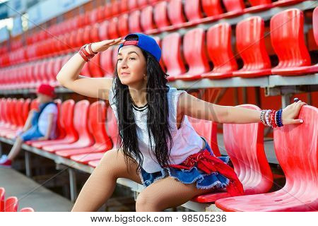 Rapper attitude rap singer hip Hop Dancer performing. Stylish woman and little boy sitting in the stands of stadium. poster