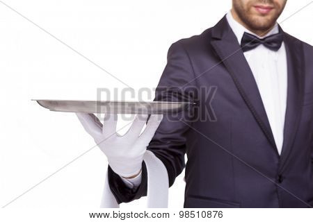 Cropped image of a waiter holding an empty silver tray, isolated on white background poster