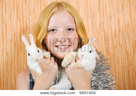 teenager girl in tinsel with two pet rabbits poster