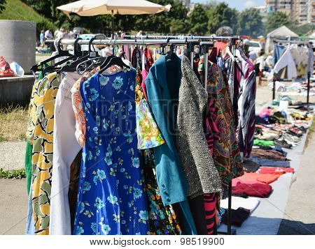 Clothes On A Rack In A Flea Market.