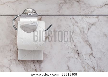Toilet Paper In White Clean Bathroom