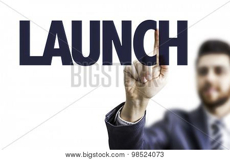 Business man pointing the text: Launch