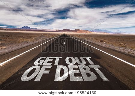 Get Out of Debt written on desert road