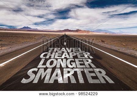 Travel Cheaper Longer Smarter written on desert road
