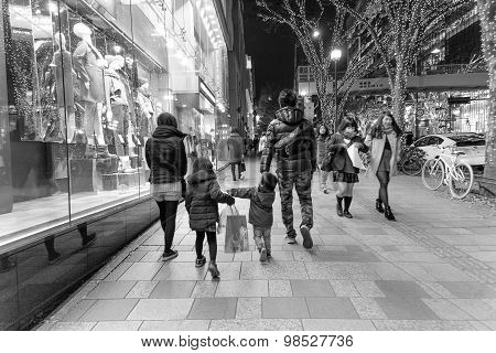 Tokyo, Japan. 10 December 2014 - The Japanese Family Shopping And Relax On The Street At Omotesando.