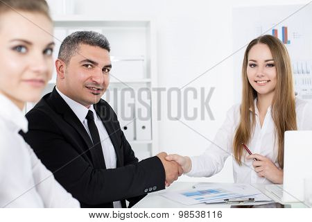 Businessman In Suit Shaking Business Woman's Hand