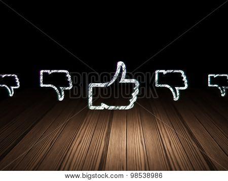 Social media concept: thumb up icon in grunge dark room