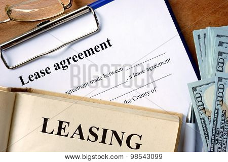 Book with word leasing,  lease agreement form.
