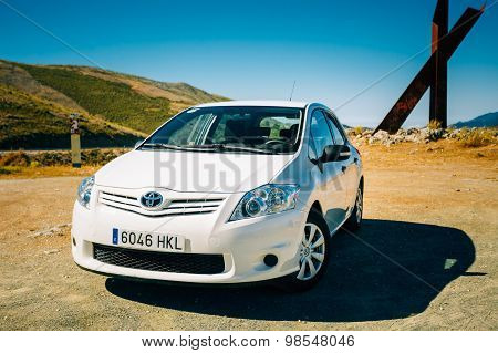 White color Toyota Auris car on Spain nature landscape