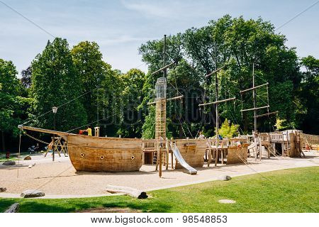 Wooden pirate boat shaped child playground in park
