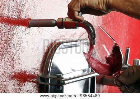 glass of red wine vineyard tap