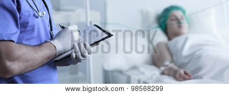 Doctor Filling In Medical Documents