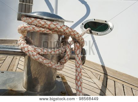 Closeup Of A Boat Capstan And Rope