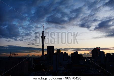 Silhouette Of Auckland Skyline At Sunrise