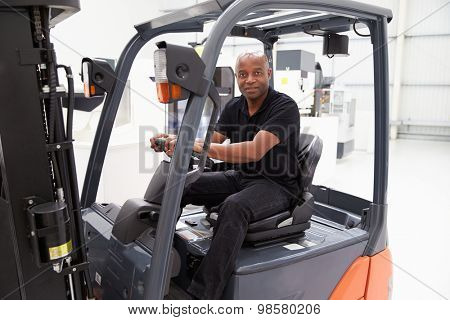 Portrait Of Male Fork Lift Truck Driver In Factory
