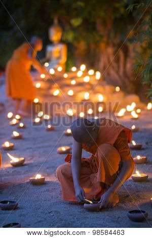 A Monk, Asalha Puja Day - July 30 : Unidentified Monks Put Candles On Floor Around Image Buddha In A