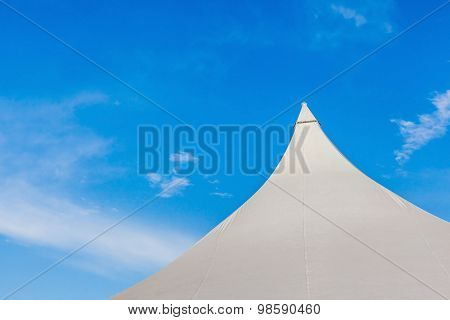 The Top Of Big Canvas Event Tent Under The Beautiful Clear Blue Sky.