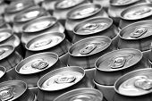 Lots aluminum beer cans. Black and white image. Shallow DOF! poster