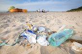 Garbage on a beach left by tourist environmental pollution concept picture Baltic Sea coast Poland. poster