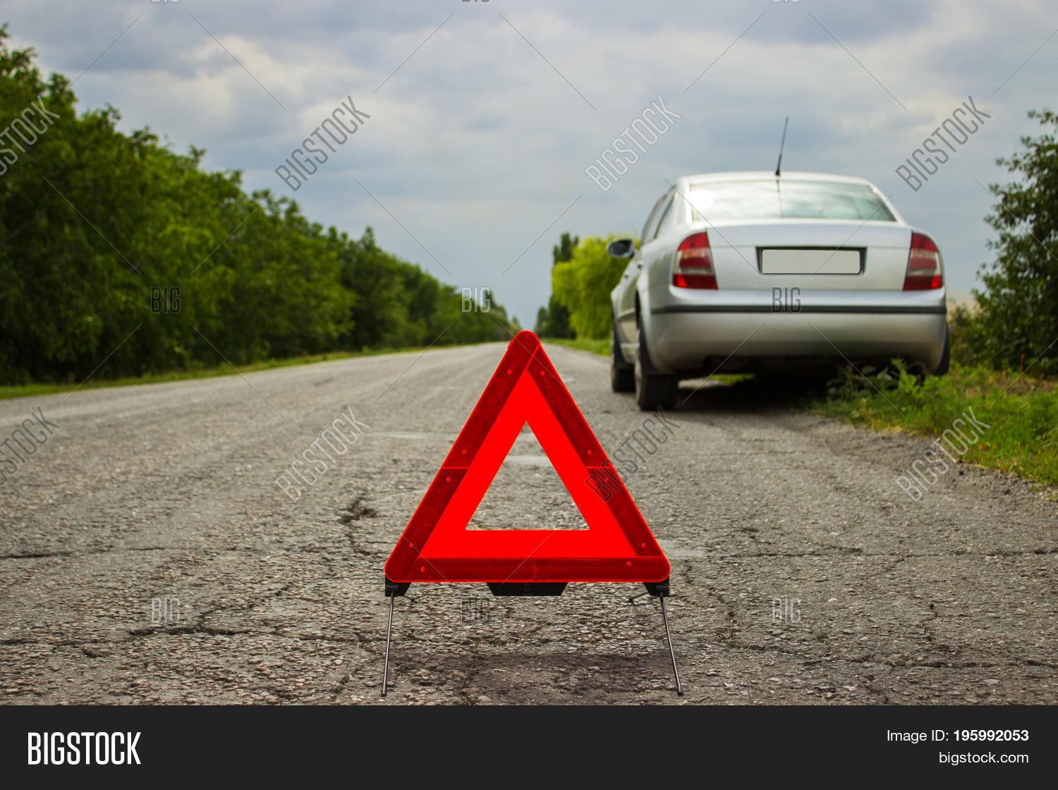 Red Triangle Of A Car On The Road Warning Against