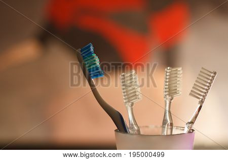 Tooth brushes on beautiful blur background in room.