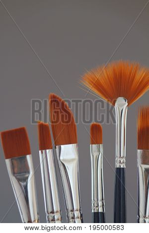 Artistic brushes in the workshop. Brushes artist on neutral grey background in the studio for artists.