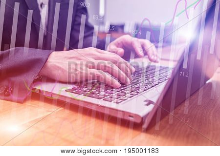 Double exposure stock financial on hand of businessman typing on laptop keyboard. Financial stock market economy analysis. Business people and Economy financial concept.