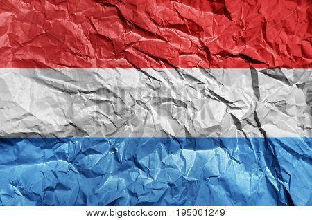 Luxembourg flag painted on crumpled paper background