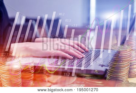 Double exposure stock financial on hand of business woman typing on laptop keyboard with coin stack. Financial stock market economy analysis. Business people and Economy financial concept.
