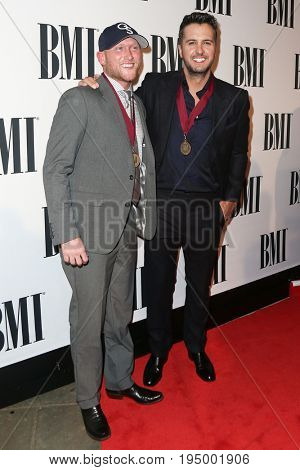 NASHVILLE, TN-NOV 3: Recording artists Cole Swindell (L) and Luke Bryan attend the 63rd annual BMI Country awards at BMI on November 3, 2015 in Nashville, Tennessee.