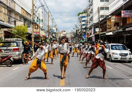 NAKHON RATCHASIMA THAILAND - JULY 9 2017: Unidentified Thai people with ancient dress dance at Candle festival parade at Korat town. Big candle used in temple during raining season.