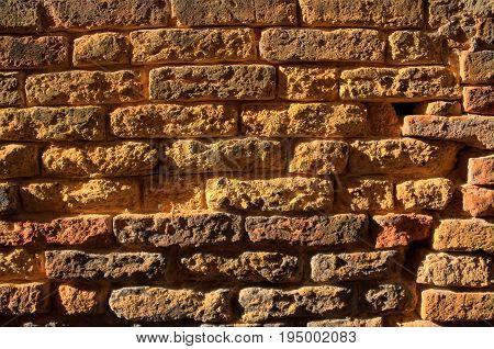 High Dynamic Range image of eroded brick wall.