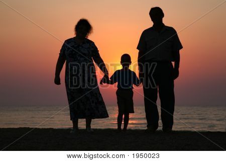 Silhouettes Of People On A Sunset