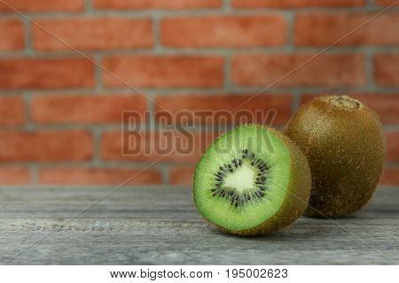 Fresh kiwi fruits on wooden background.Ripe kiwi fruits.