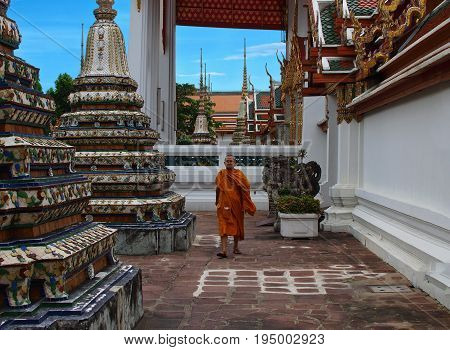 BANGKOK - THAILAND - AUGUST 2008: Tibetan monk walks between the pillars of the temple. Entrance with monk of Tibetan Buddhism Temple